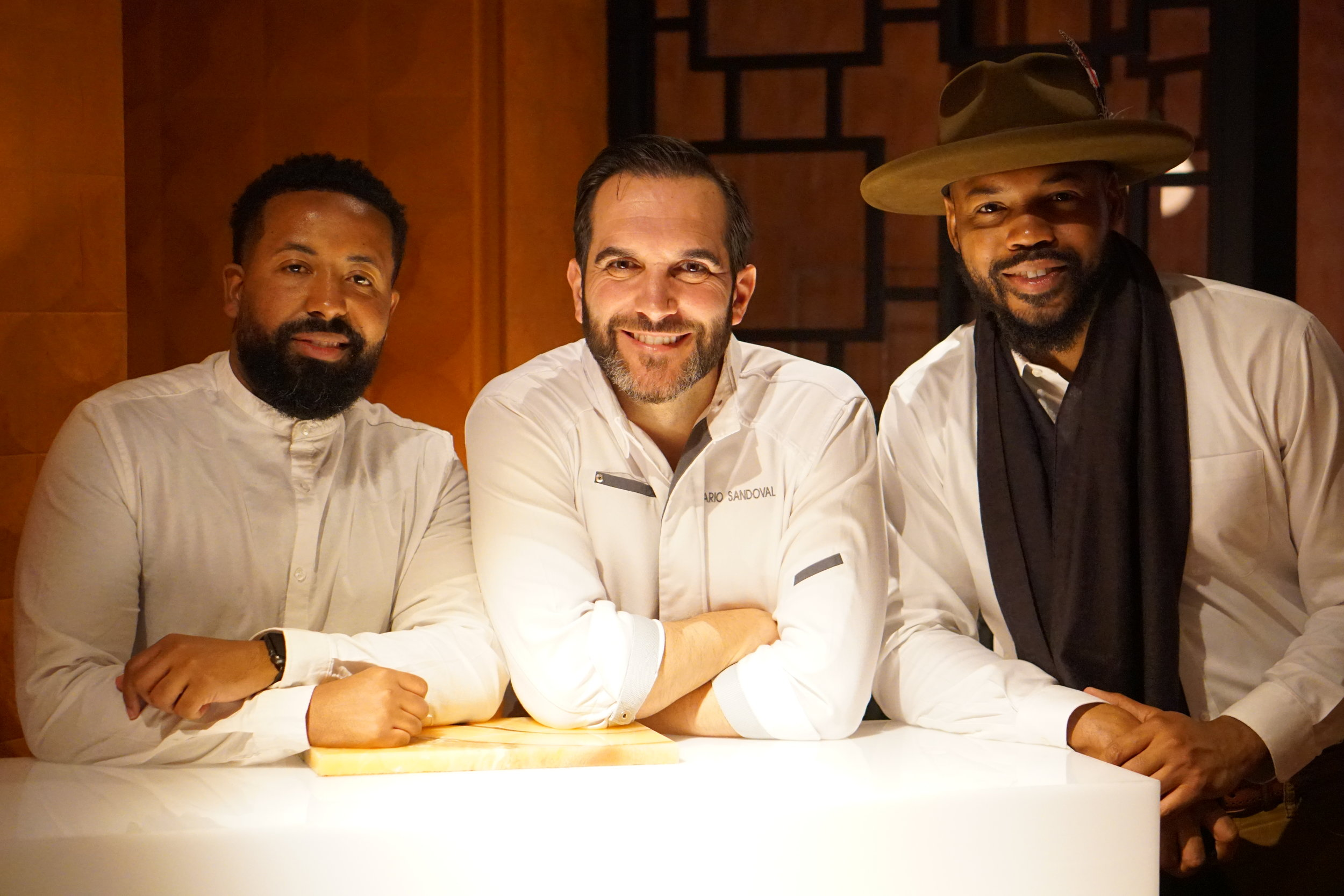 From left: Kent Johnson of Black & Abroad, Chef Mario Sandoval of Coque & Eric Martin of Black & Abroad.