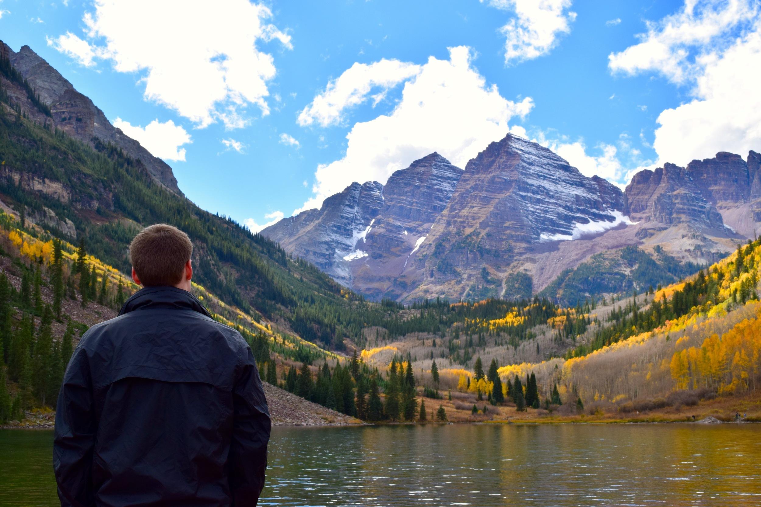 Logan looking across Maroon Lake at the Maroon Bells (aka the Deadly Bells)