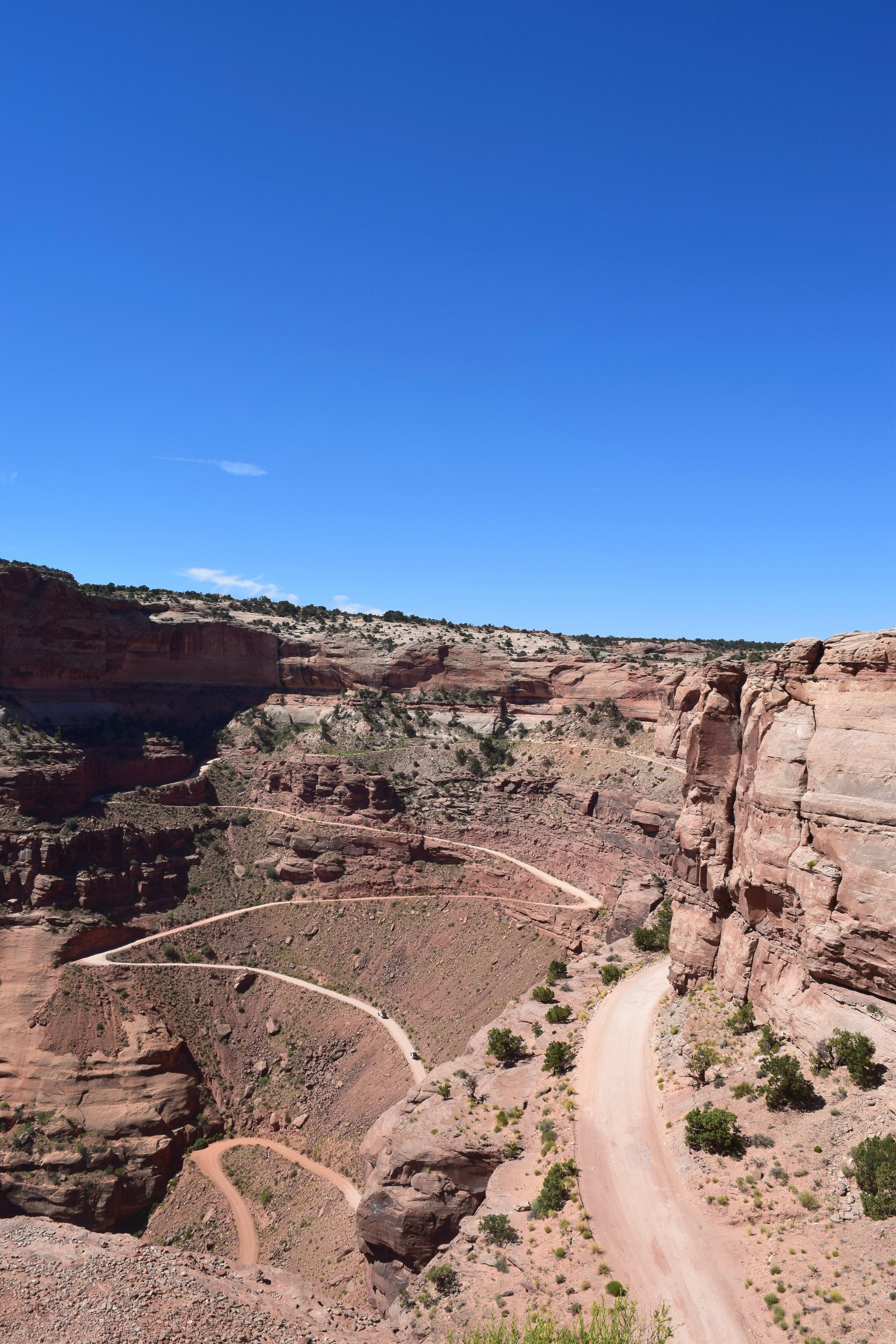 Shafer Trail (leads to White Rim Road)with two full sized jeeps for scale. This road used to be used for herding livestock, imagine making this climb/descent several times with hundreds of sheep in front of you.