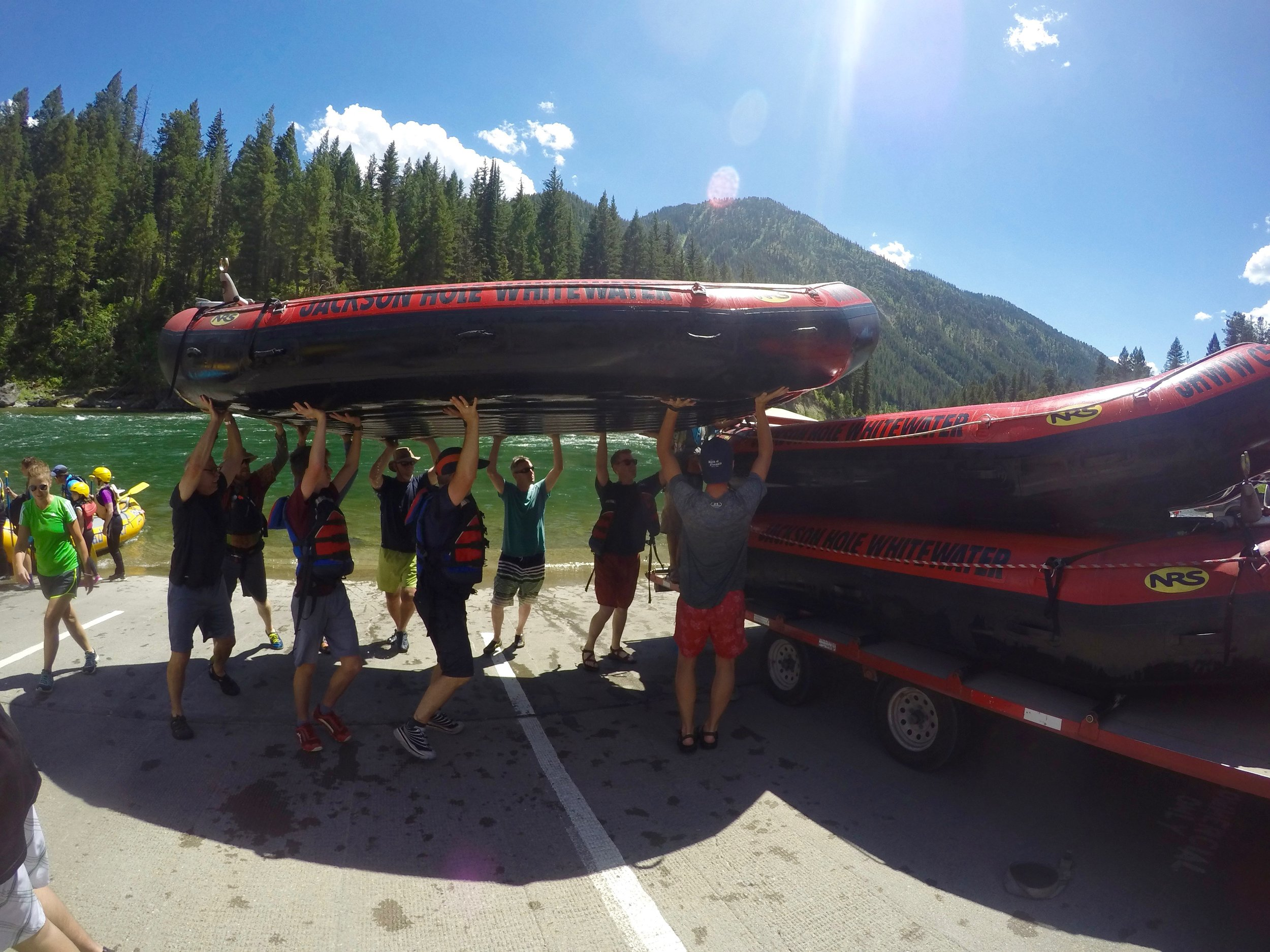 The boys had to help put all the rafts on the trailers