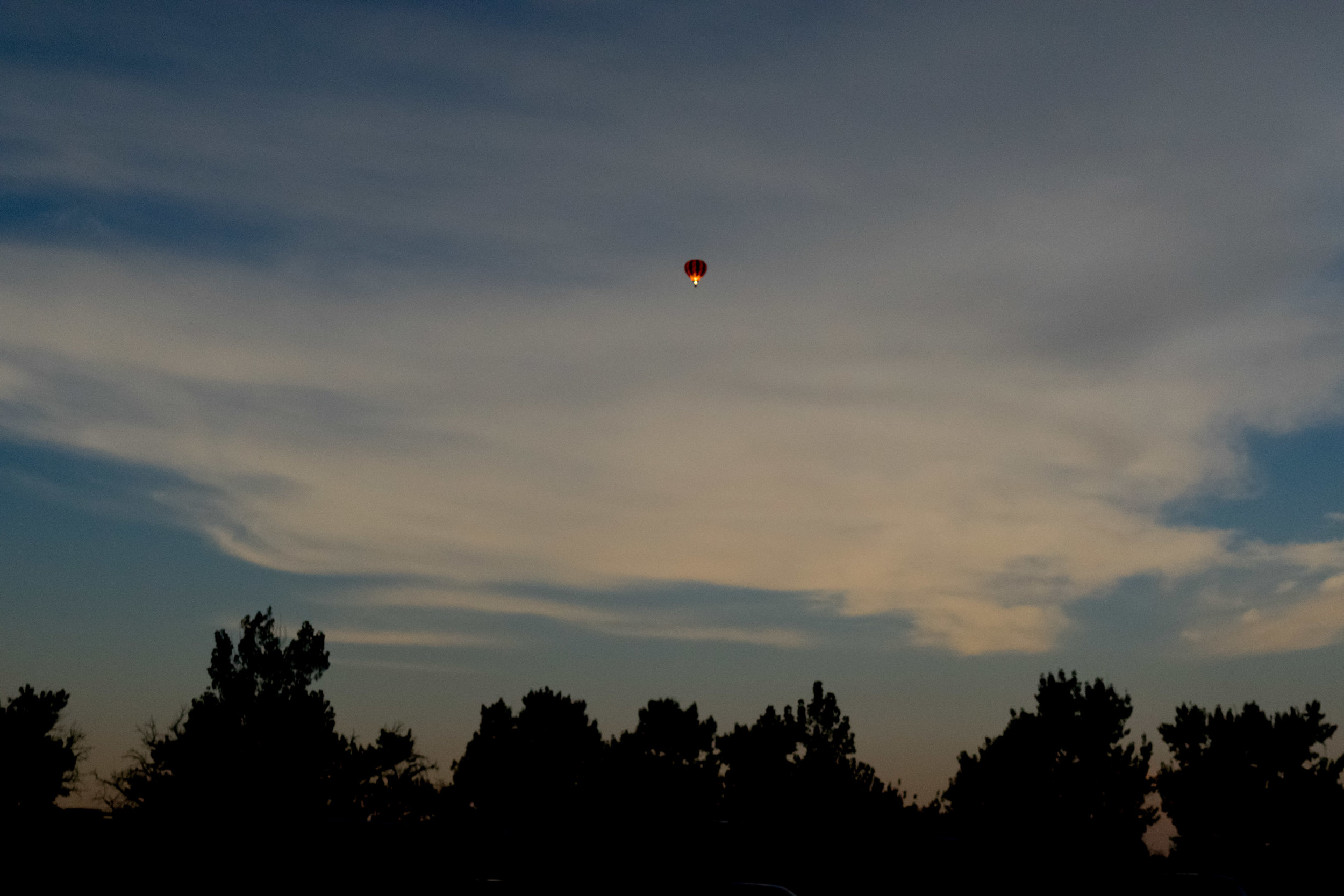 A hot air balloon behind us during totality.