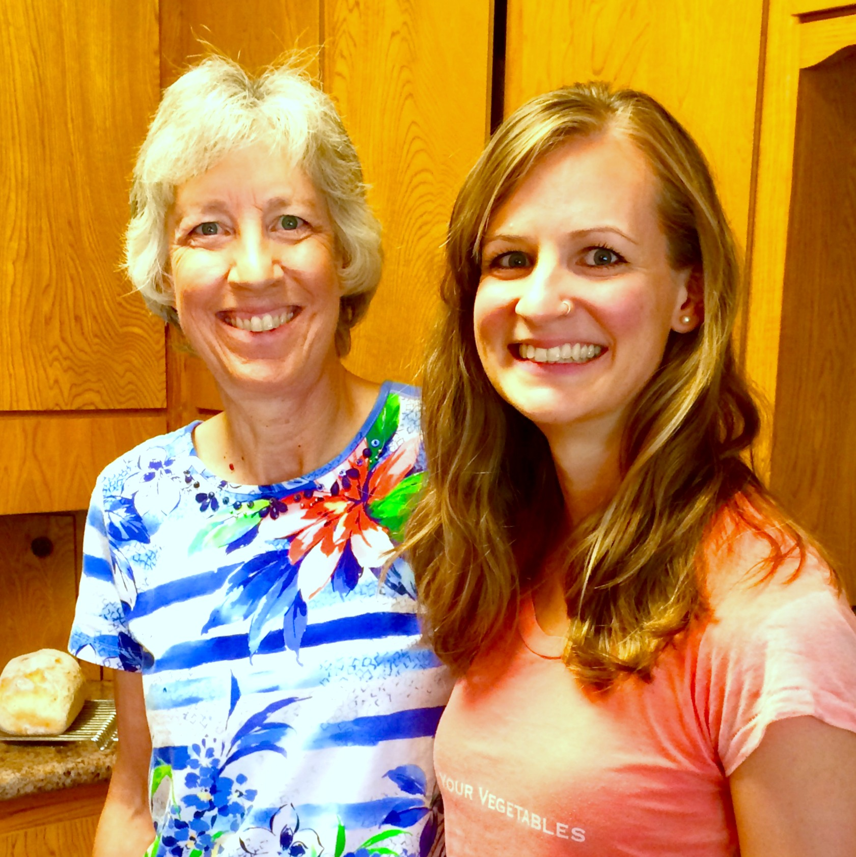 My mom and me, a couple of weeks ago. Yes, that's a loaf of fresh bread behind her.