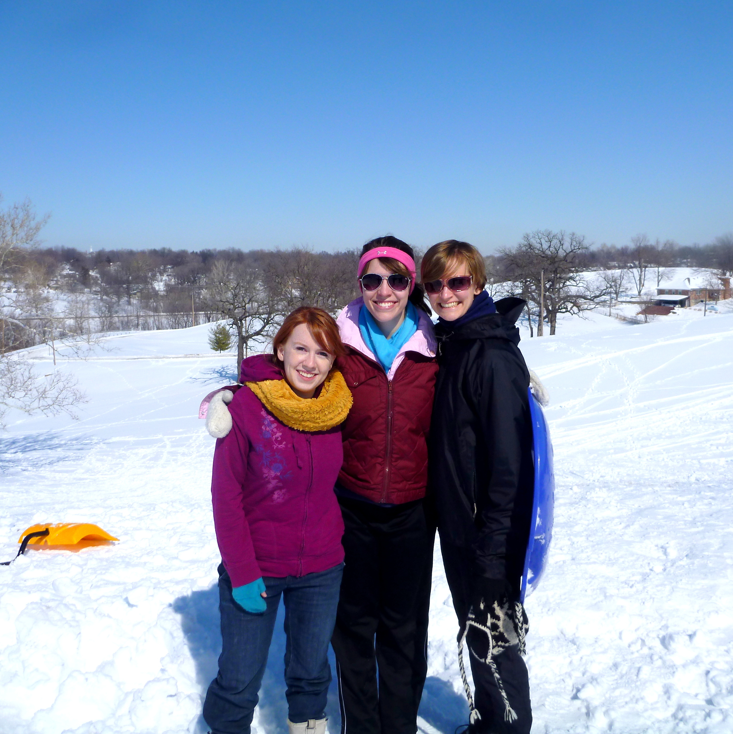 Sledding with friends Caitlin and Brie