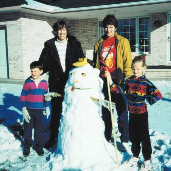 Building a snowman with brother Ray, Mom, and Aunt Sue