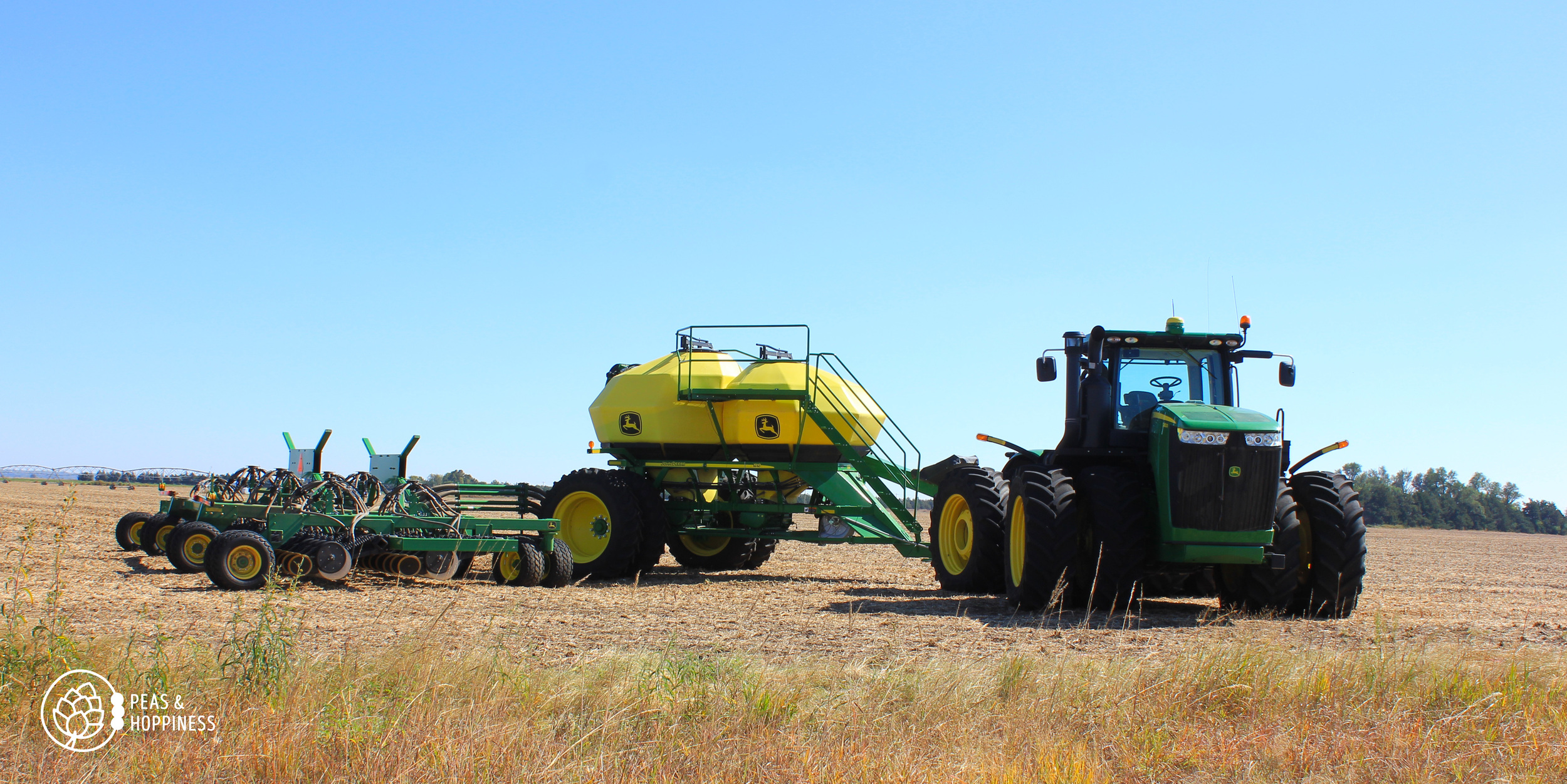 The air-seeder, used to drill wheat. The front hopper contains wheat seed; the rear hopper contain dry synthetic nitrogen