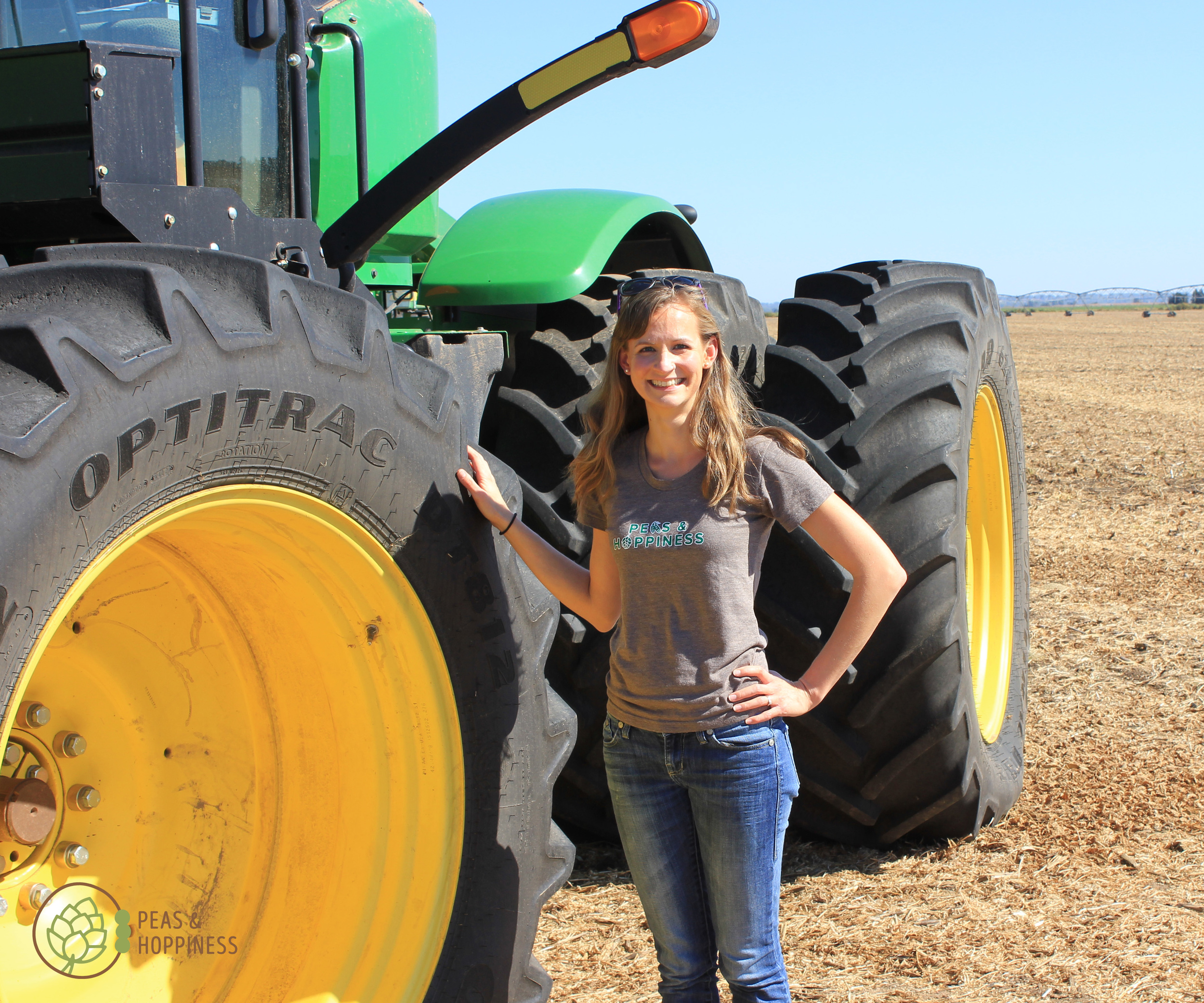 Standing next to the giant tire of the air seeder. This big equipment is what makes Kansas the bread basket of the world!