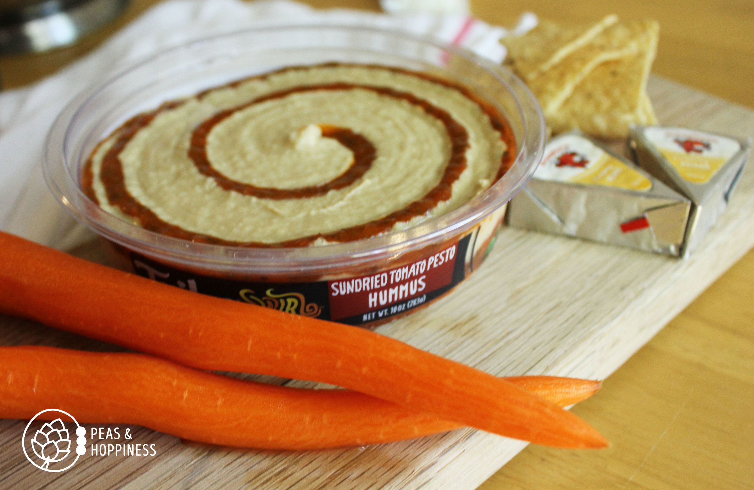 Lunch idea: Laughing Cow cheese + hummus/chips + carrots
