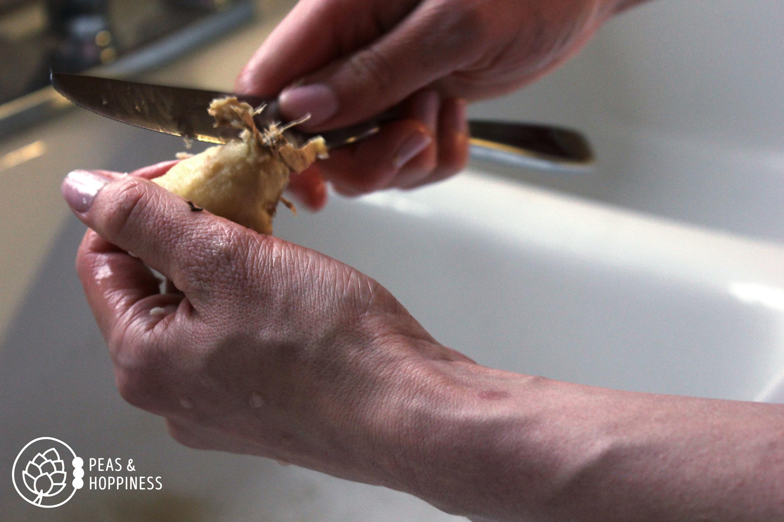 Peeling fresh ginger root