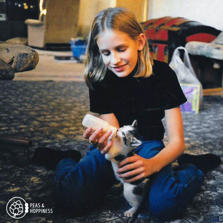 Young Ann, feeding baby Oreo, the rescued kitten