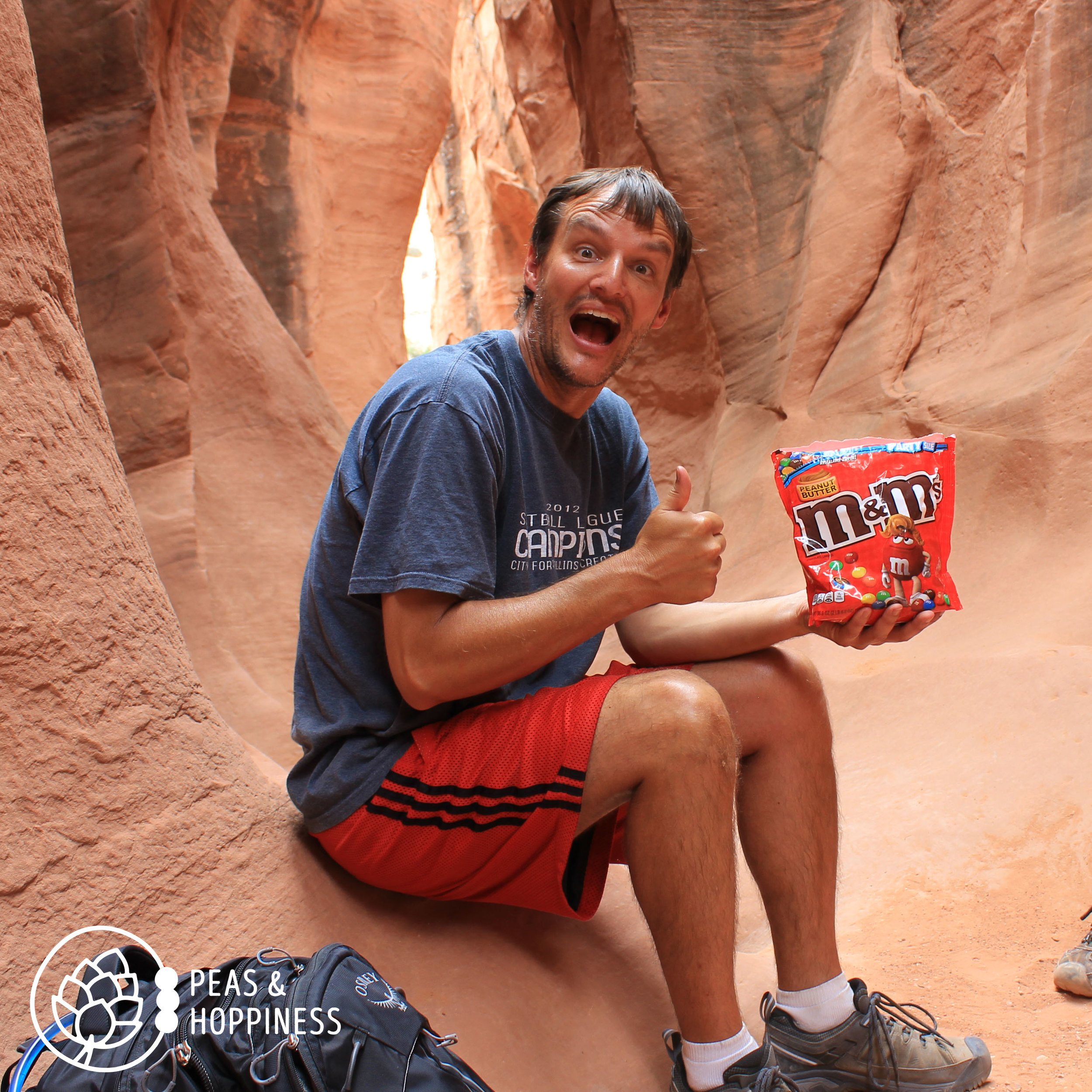 I'm not sure if he's delirious from the sun and lack of calories or if I'm finally rubbing off on him and he's really that excited about peanut butter M&Ms! A tasty treat in the slot canyons