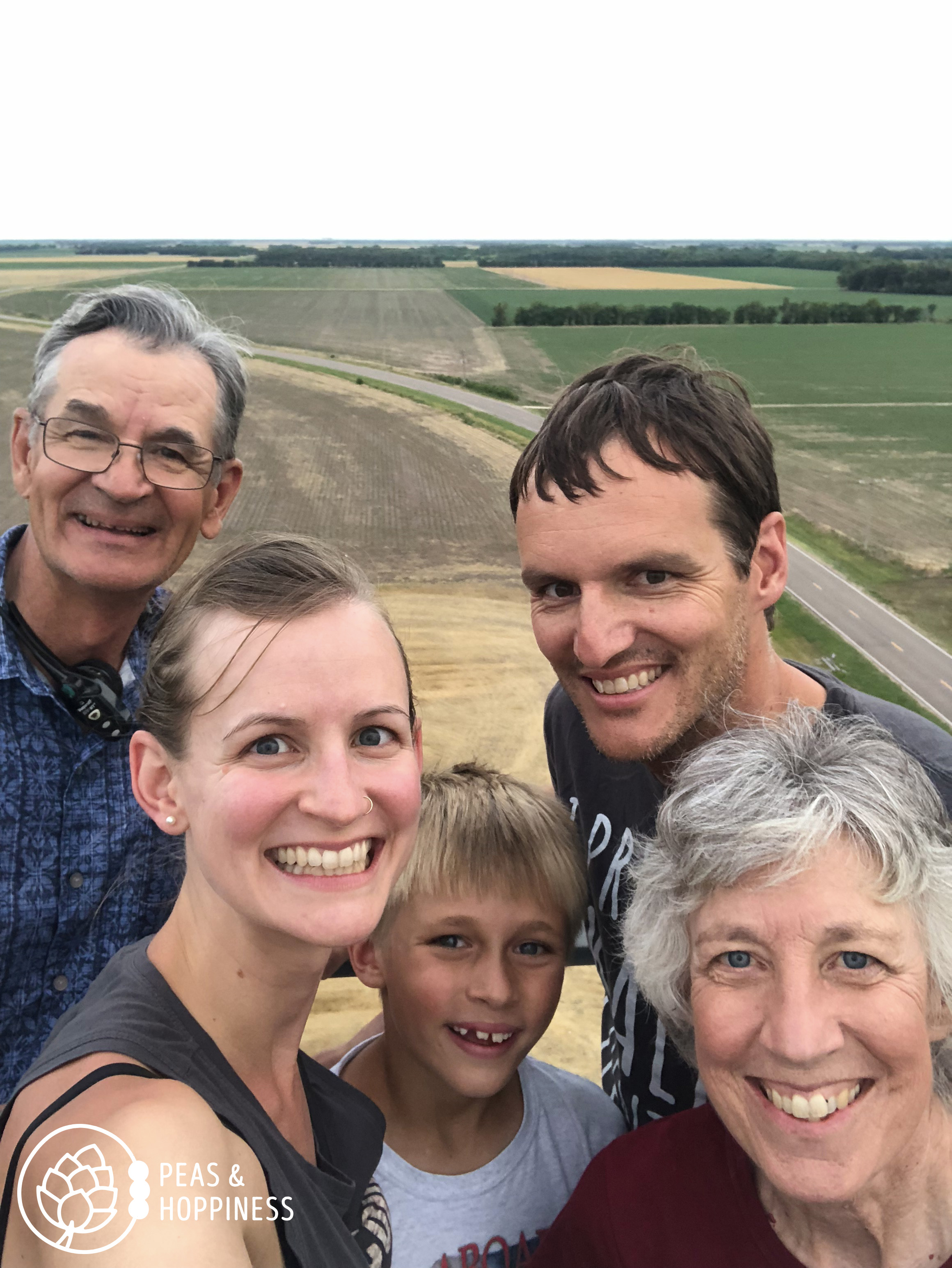 Our kind of entertainment: climbing to the top of my parents' grain-handling facility with the family!