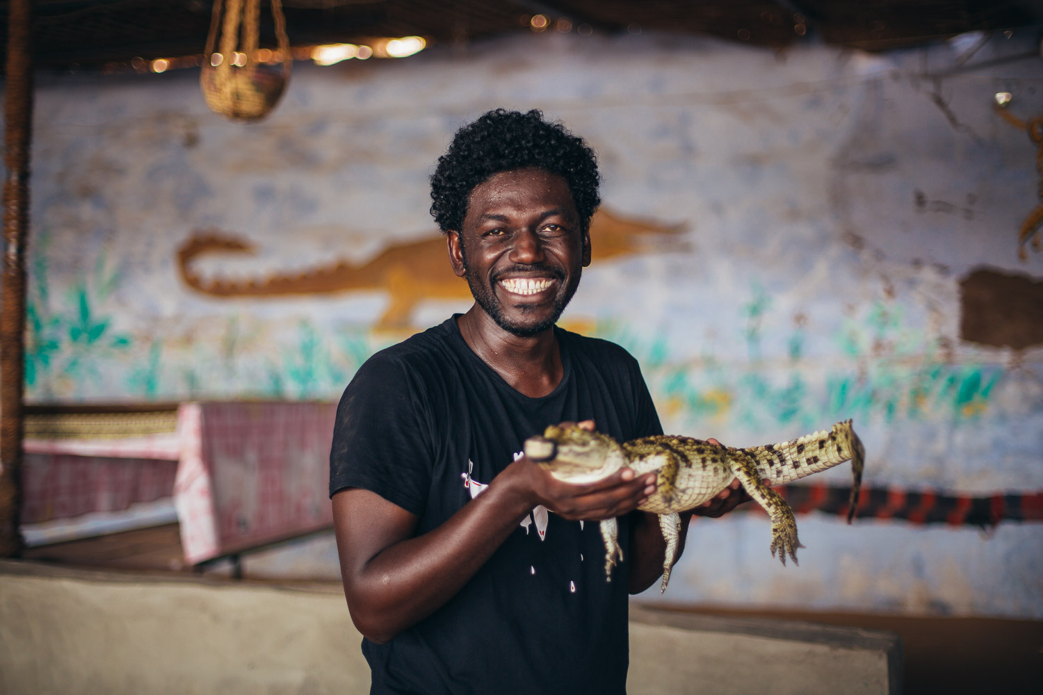 No there is no image of me holding the baby croc, however I present you with a picture of Mohamed holding one.