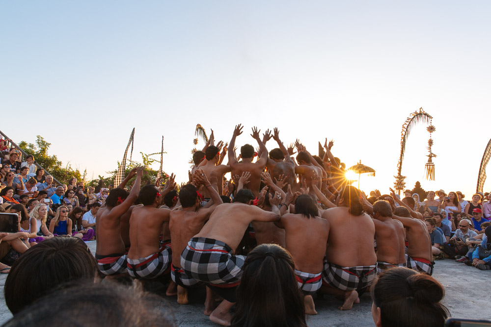 Kecak dance in motion at sunset.