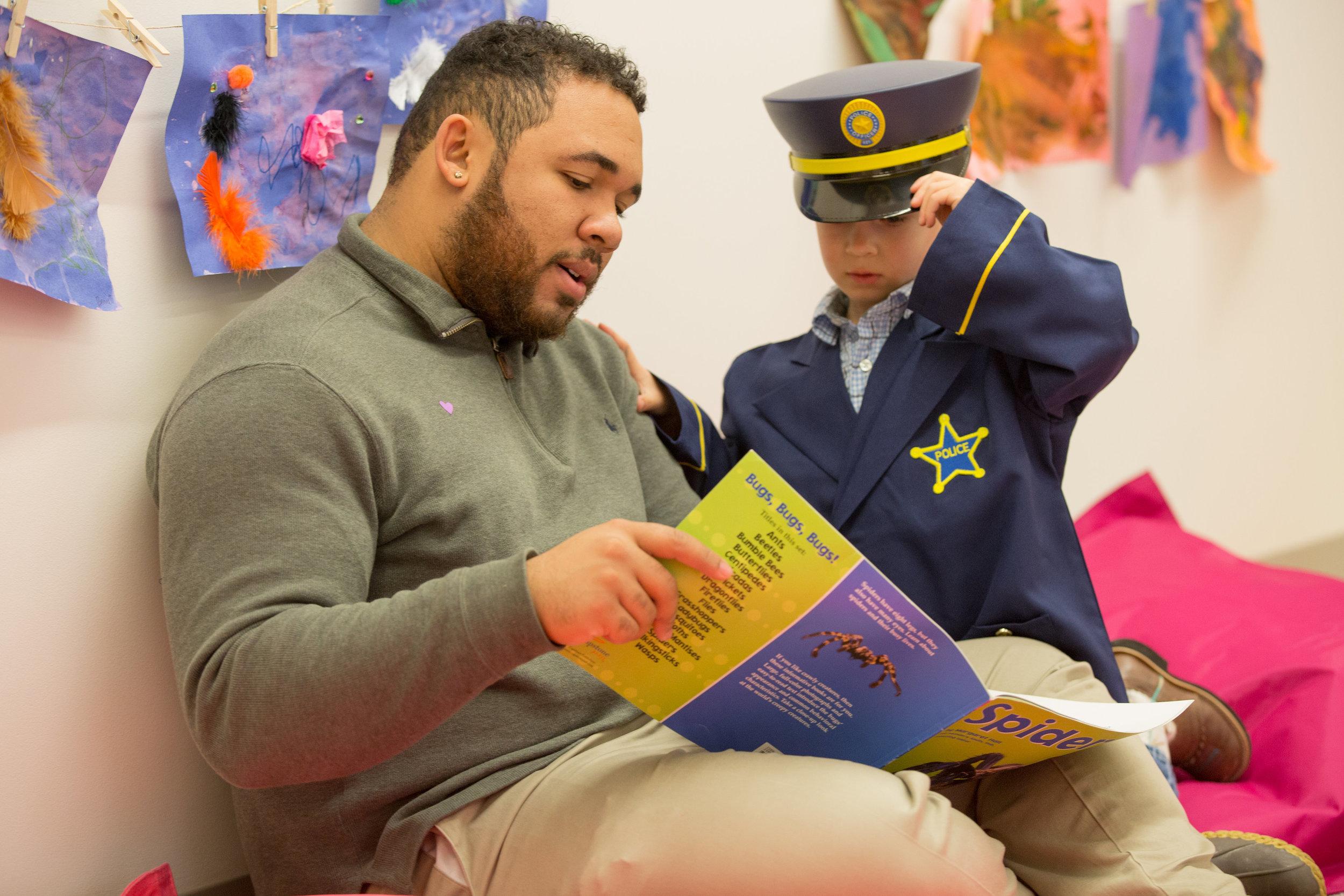 male teacher reading.jpg