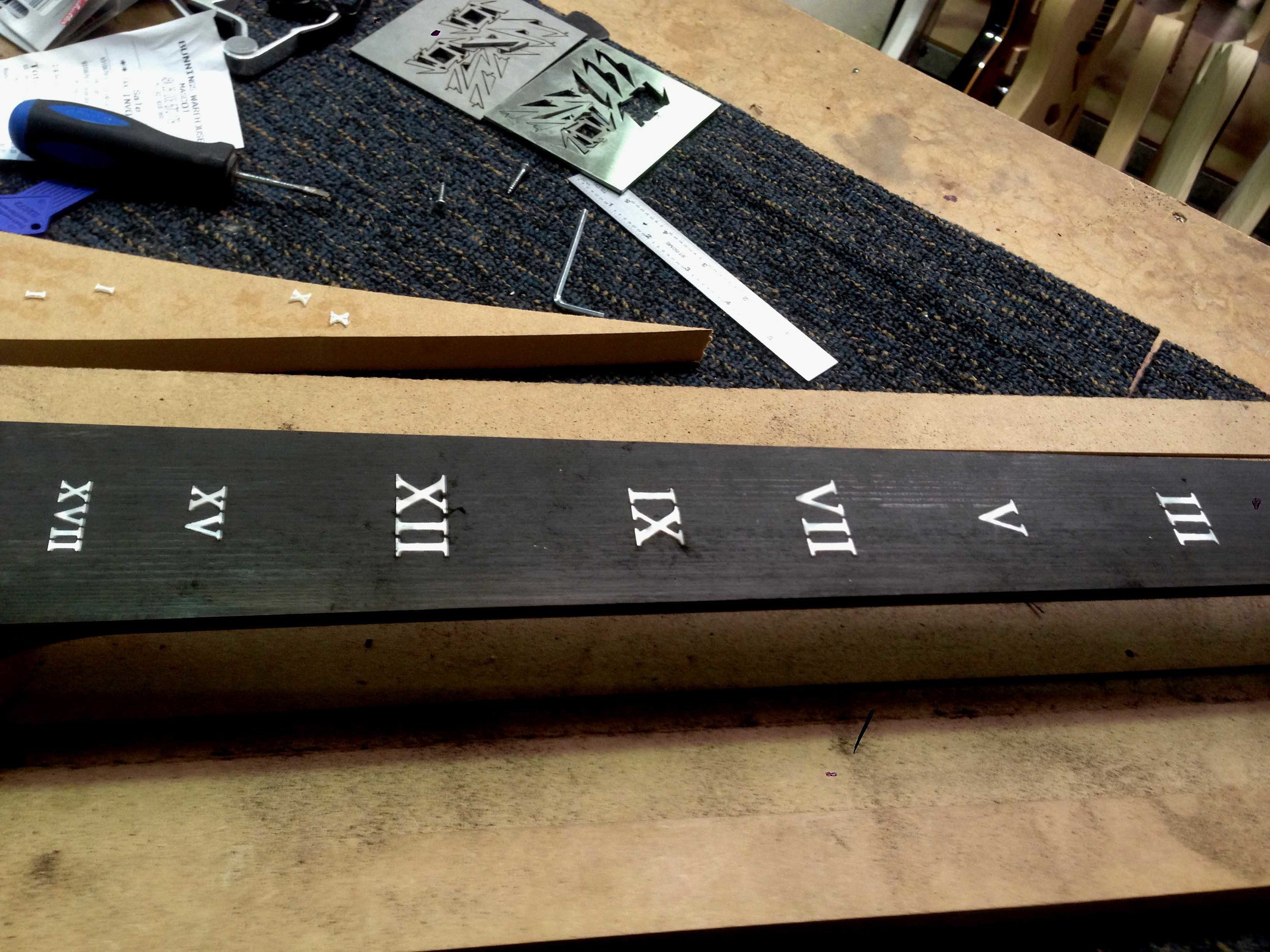 Working on a Roman numeral Inlay.jpg