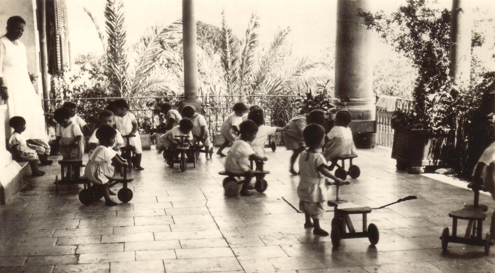 Birds' Nest children playing on carts made by older boys at Mamelstein Orphanage