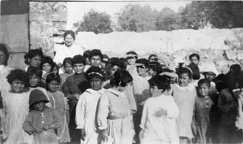 Relief worker Nellie Miller with children at Syrian orphanage