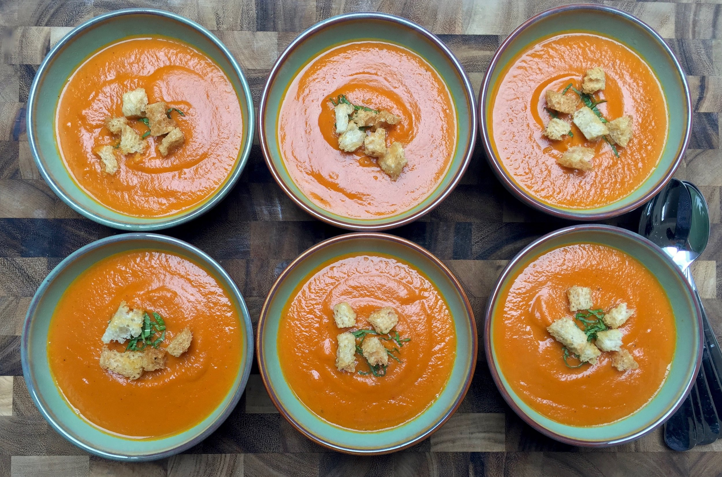 Roasted Carrot-Ginger Soup garnished with croutons and mint is ready to pass around...