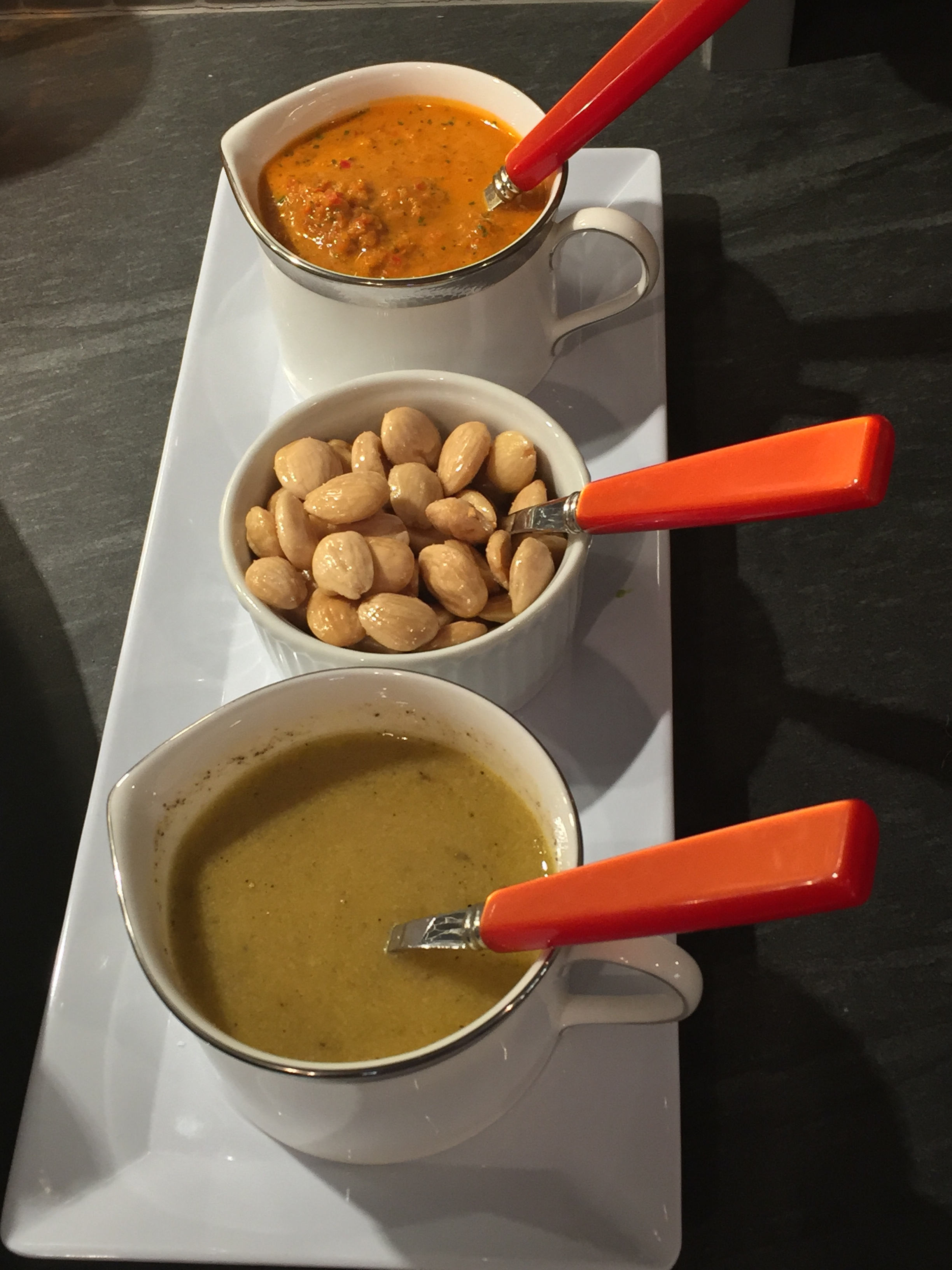 Two dressing and Marcona almonds.