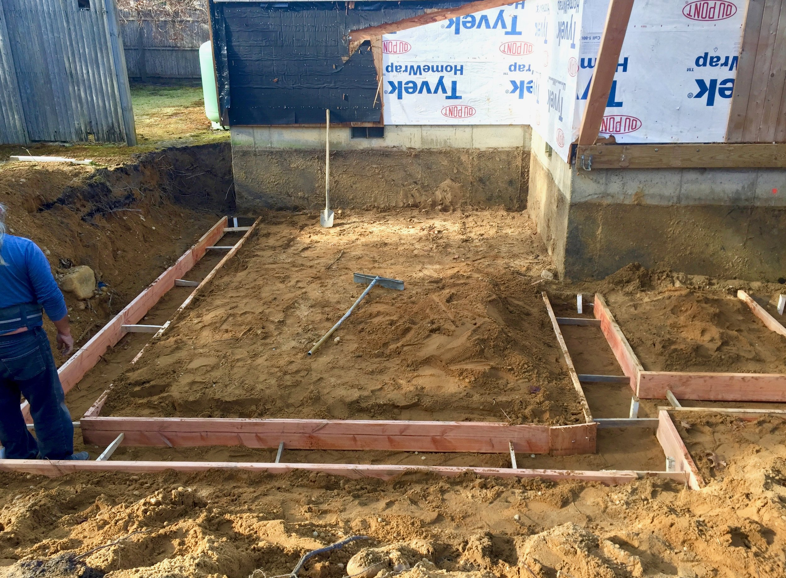 Laying the mold for the footings.