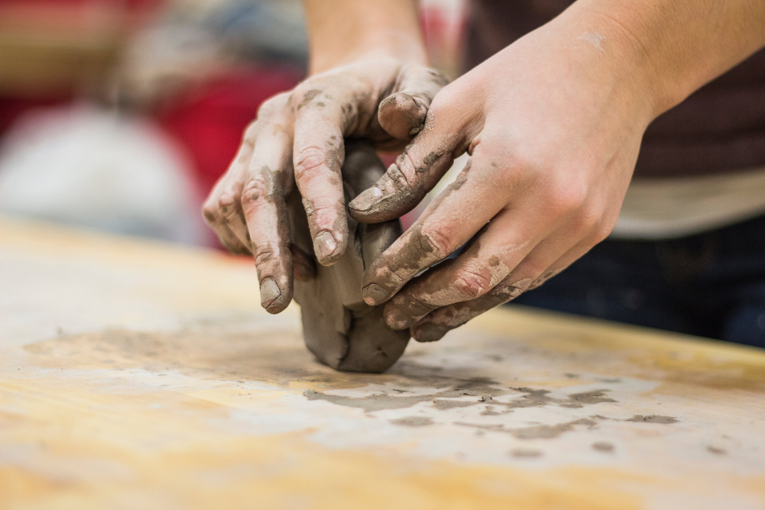Art therapy can use a variety of mediums. Clay, for example, can support reconnection with physical sensations.