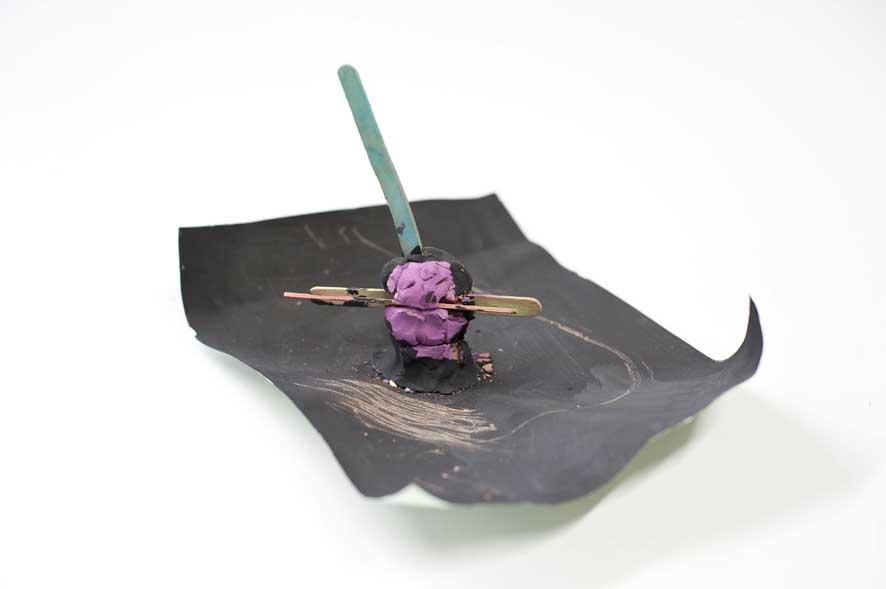 'The Sacrifice of The Rapist': Clay, wood, acrylic and paper. H16cm x W22.5cm x L29.7cm