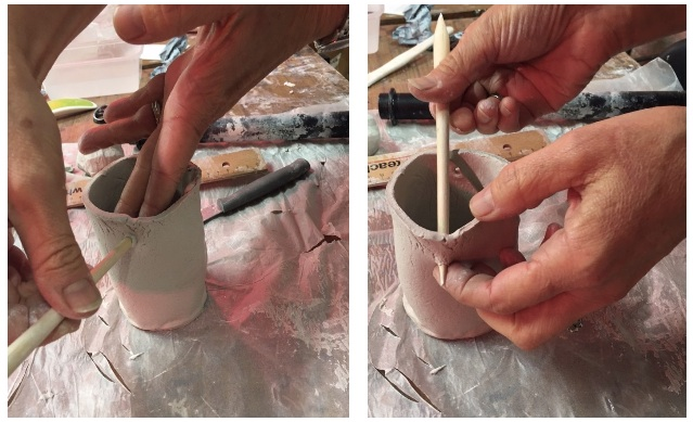 6. Punch two holes in the cylinder in order to hang it. Use a pencil and place holes an equal distance apart.
