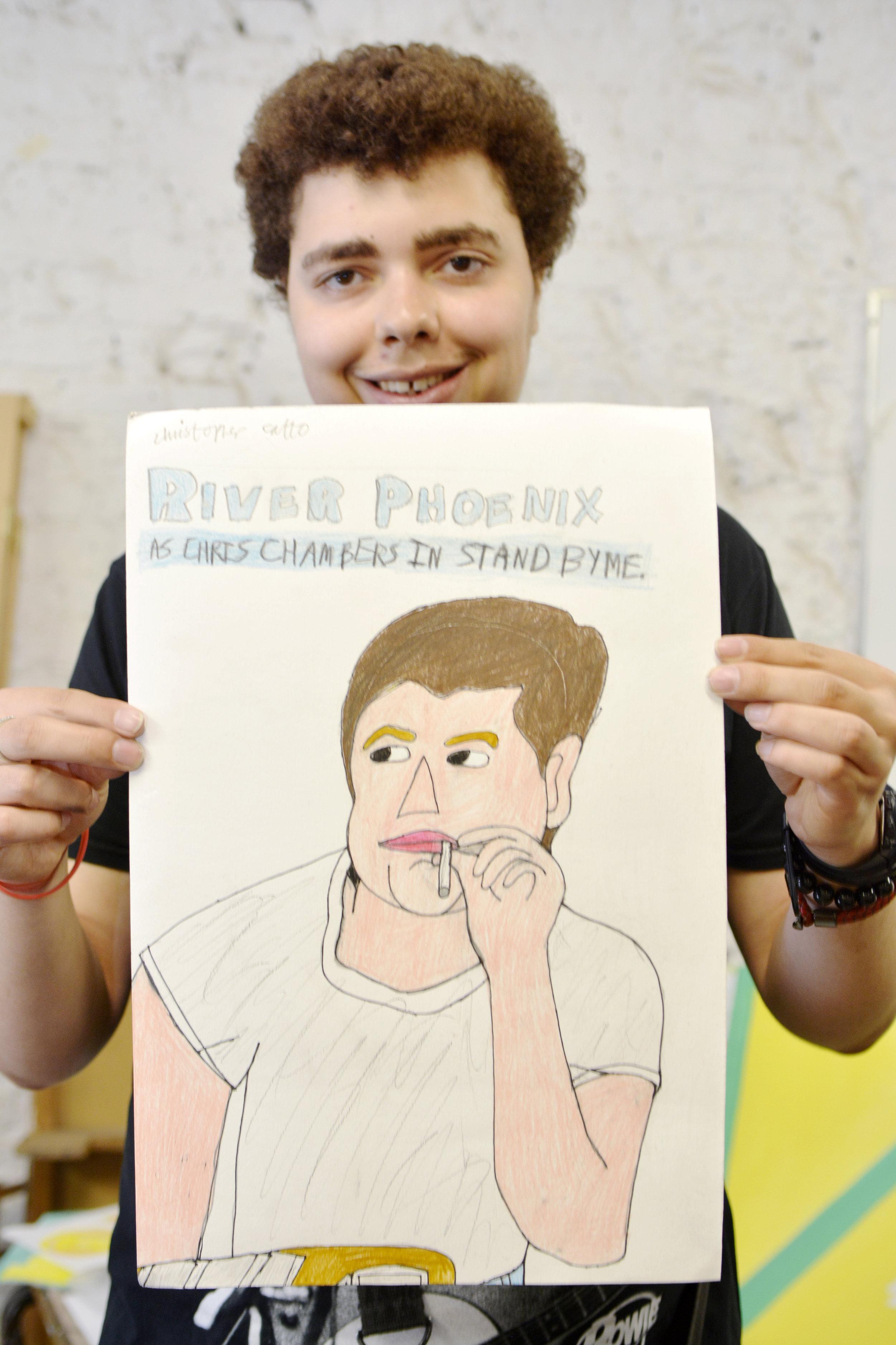 Christopher holding artwork.jpg
