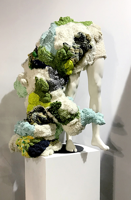 Hybrid  2019, 46 x 31 x 24 inches Mannequin, yarn, up-cycled plastic shopping bags (stuffing).