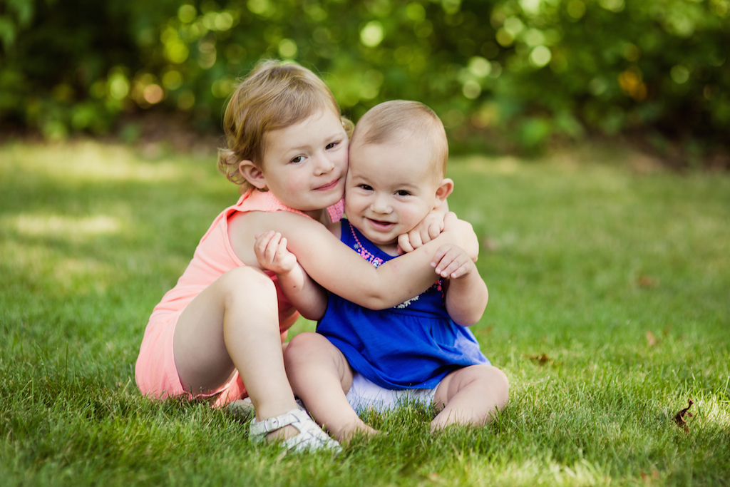 baby sisters hugging each other | cleveland kids photography