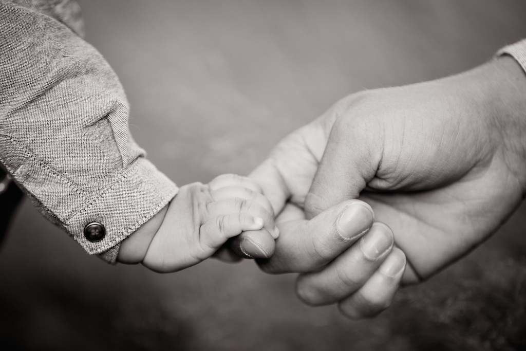 dad holding baby sons hand | cleveland baby photography