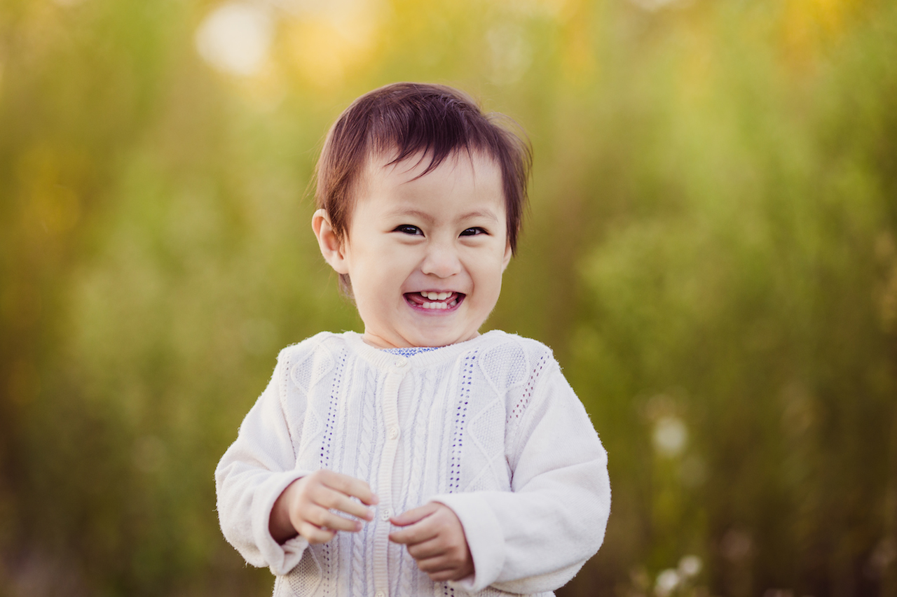 asian baby girl laughing in park | cleveland kids portraits