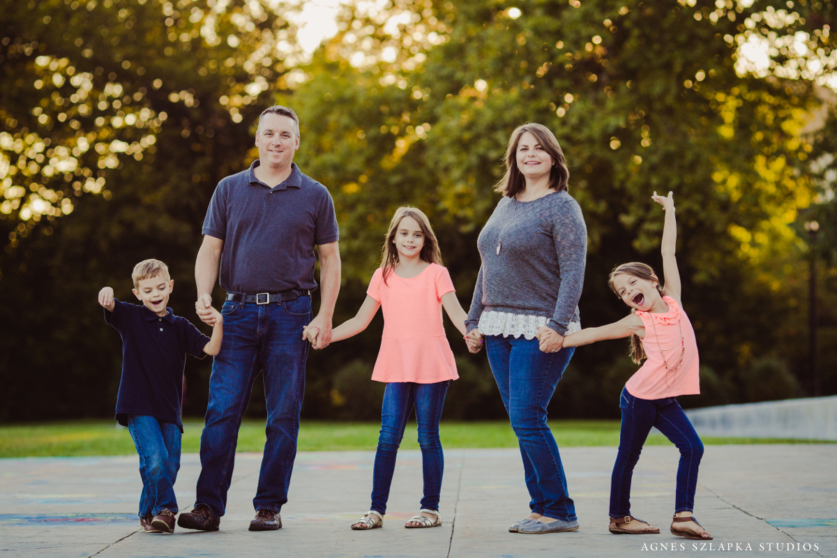 family of five holding hands | cleveland ohio lifestyle photography