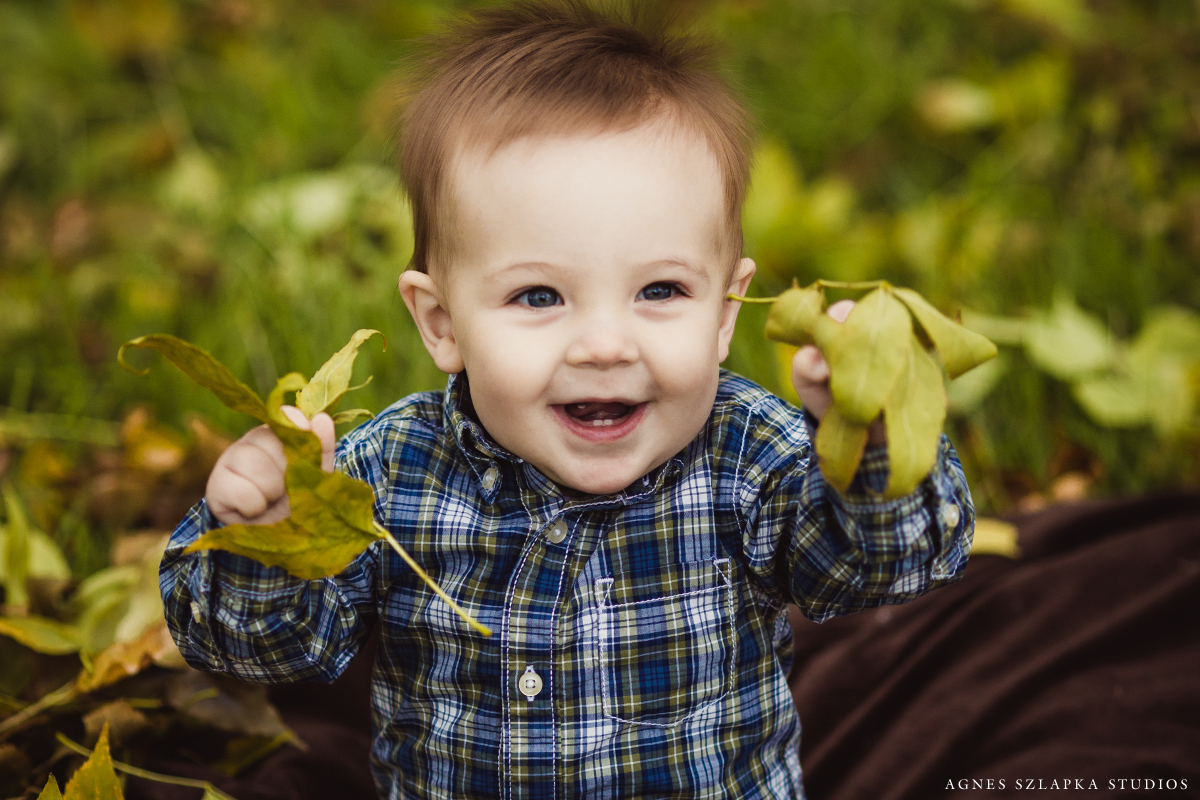baby boy smiling holding leaves | cleveland, ohio kids photographer