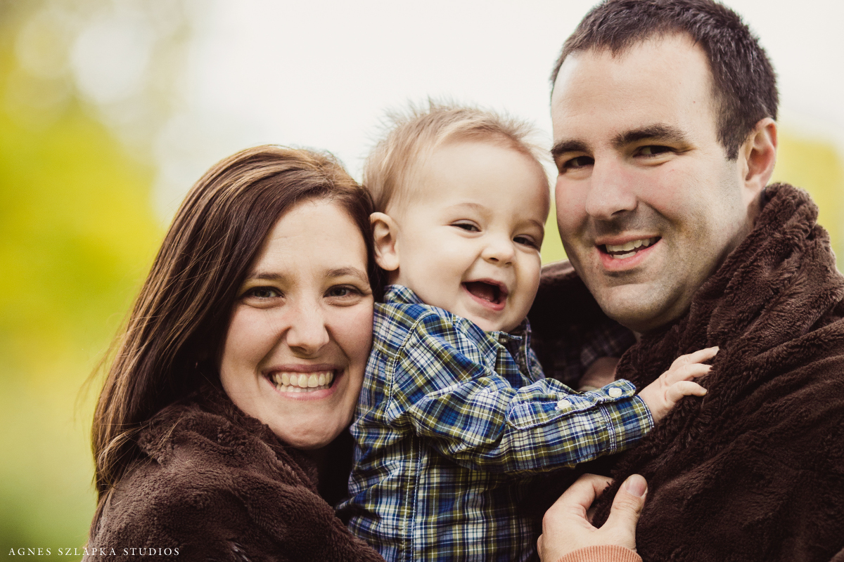 family of three wrapped with blanket-nine month old baby boy | cleveland, ohio portrait photographer