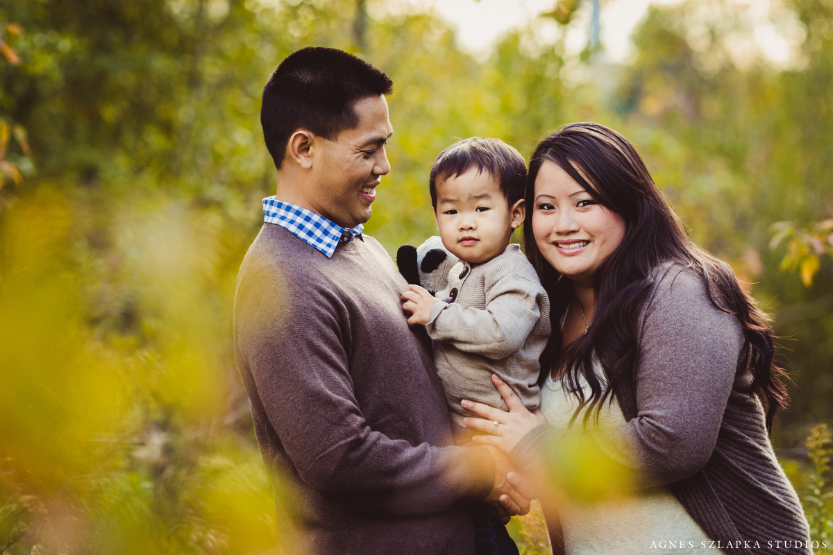 parents with baby boy in park | cleveland ohio family lifestyle photographer