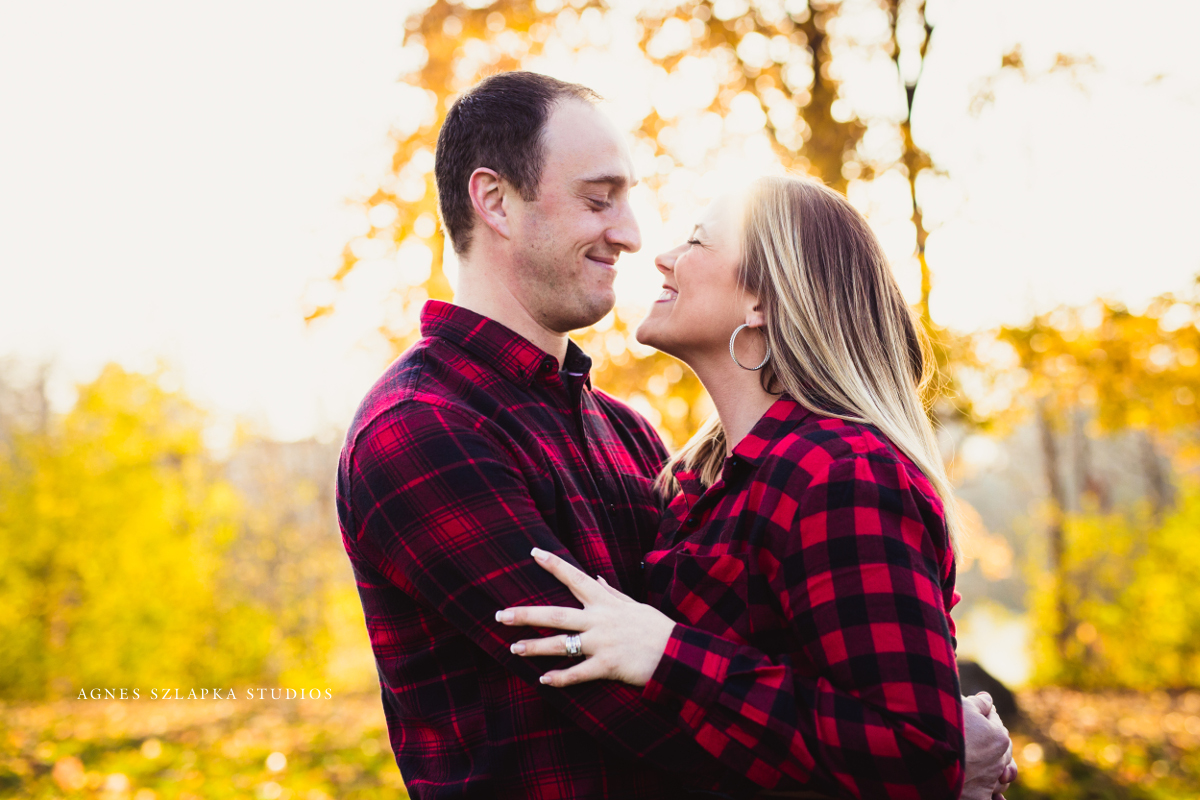 husband and wife looking in each others eyes smiling | cleveland, ohio engagement photographer