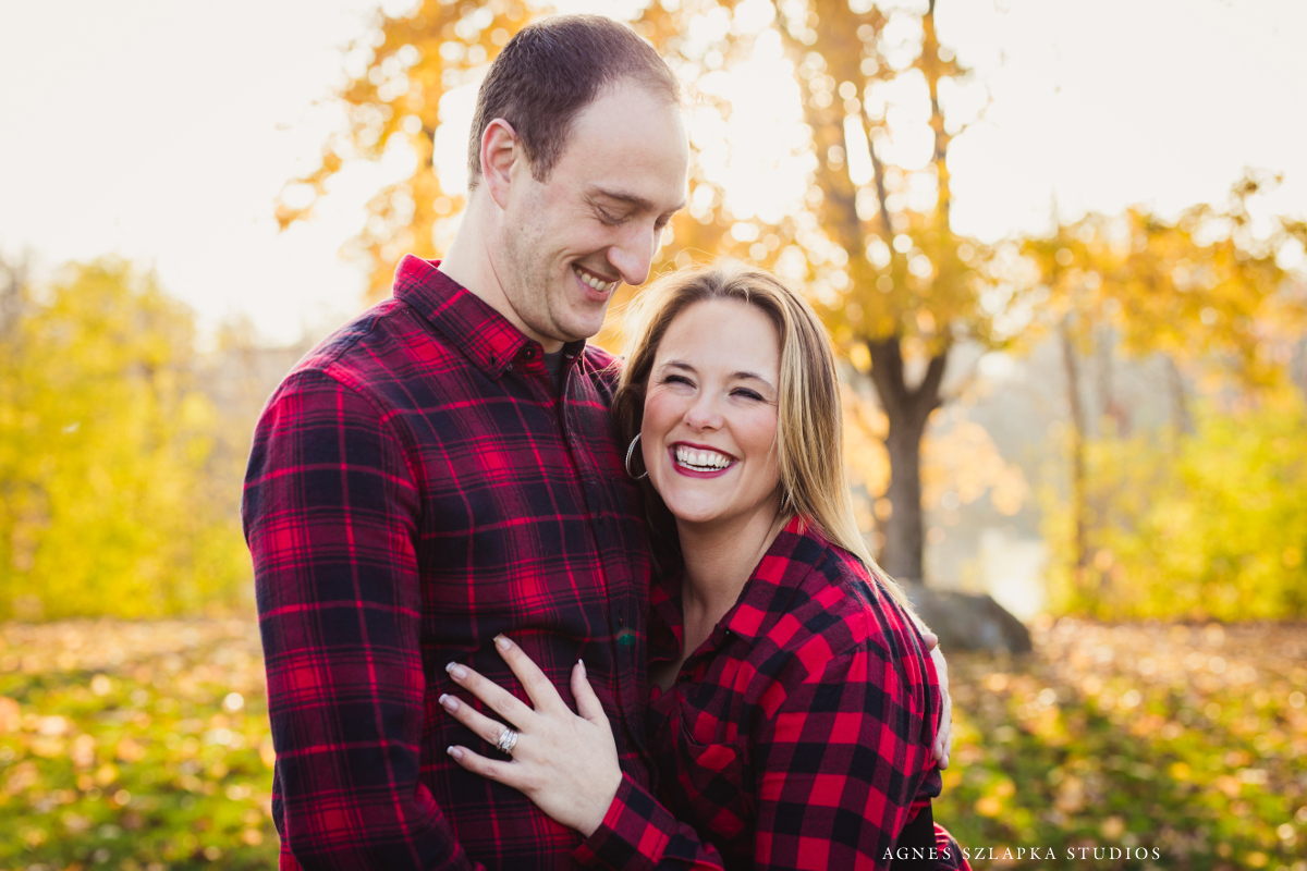 wife leaning into husband and both laughing wearing plaid | cleveland, ohio family photographer