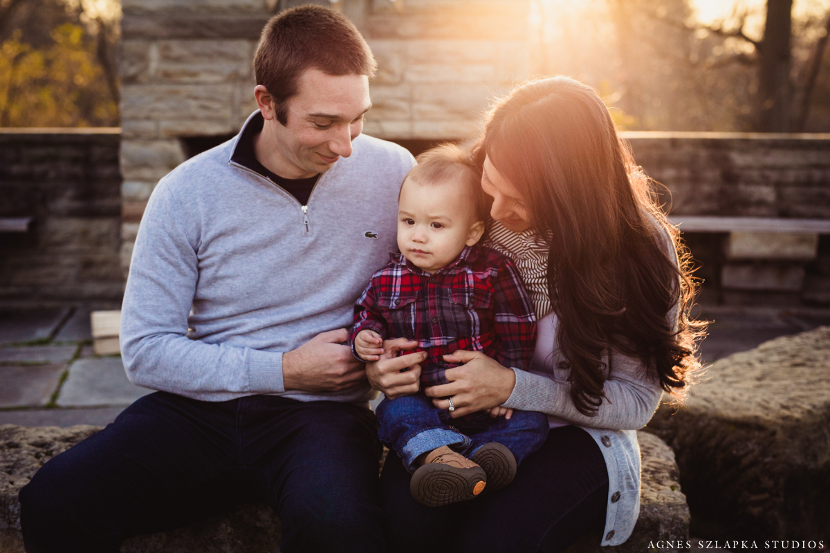 family of three sitting by fireplace | cleveland, ohio baby photography