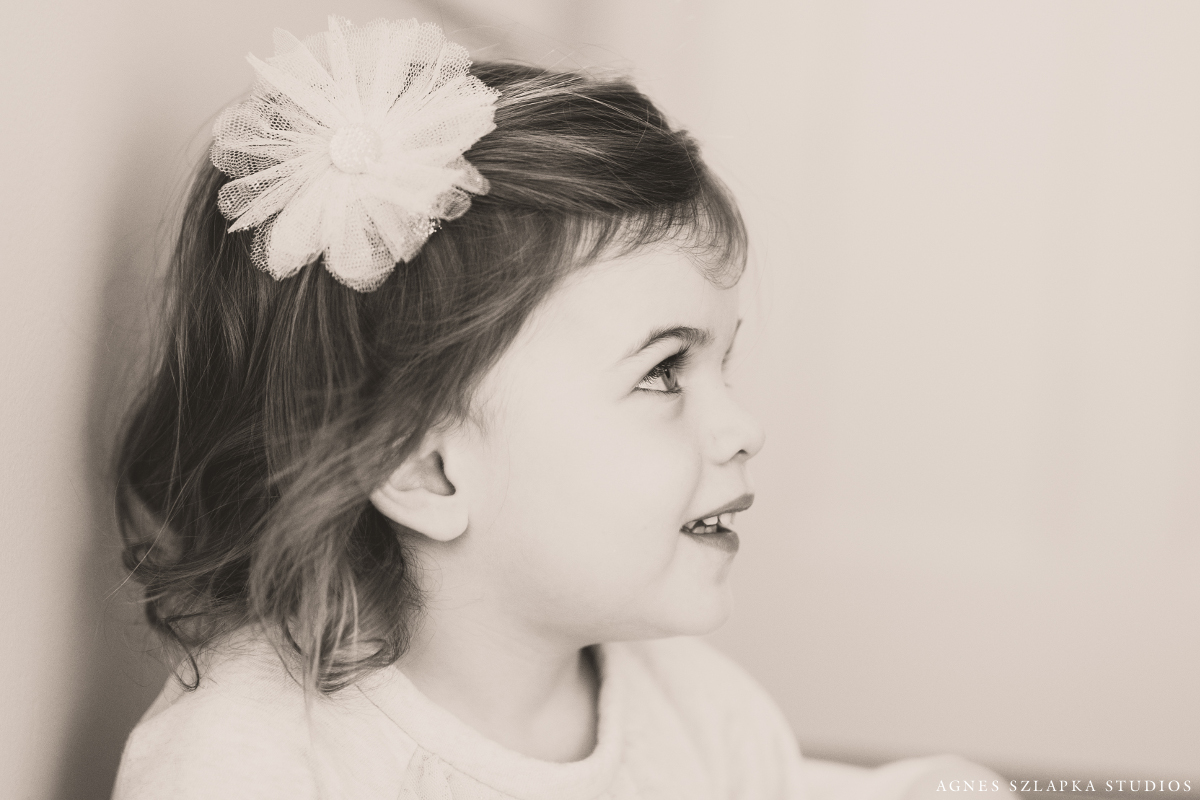 toddler girl with floral pin in hair | cleveland, ohio baby photographer