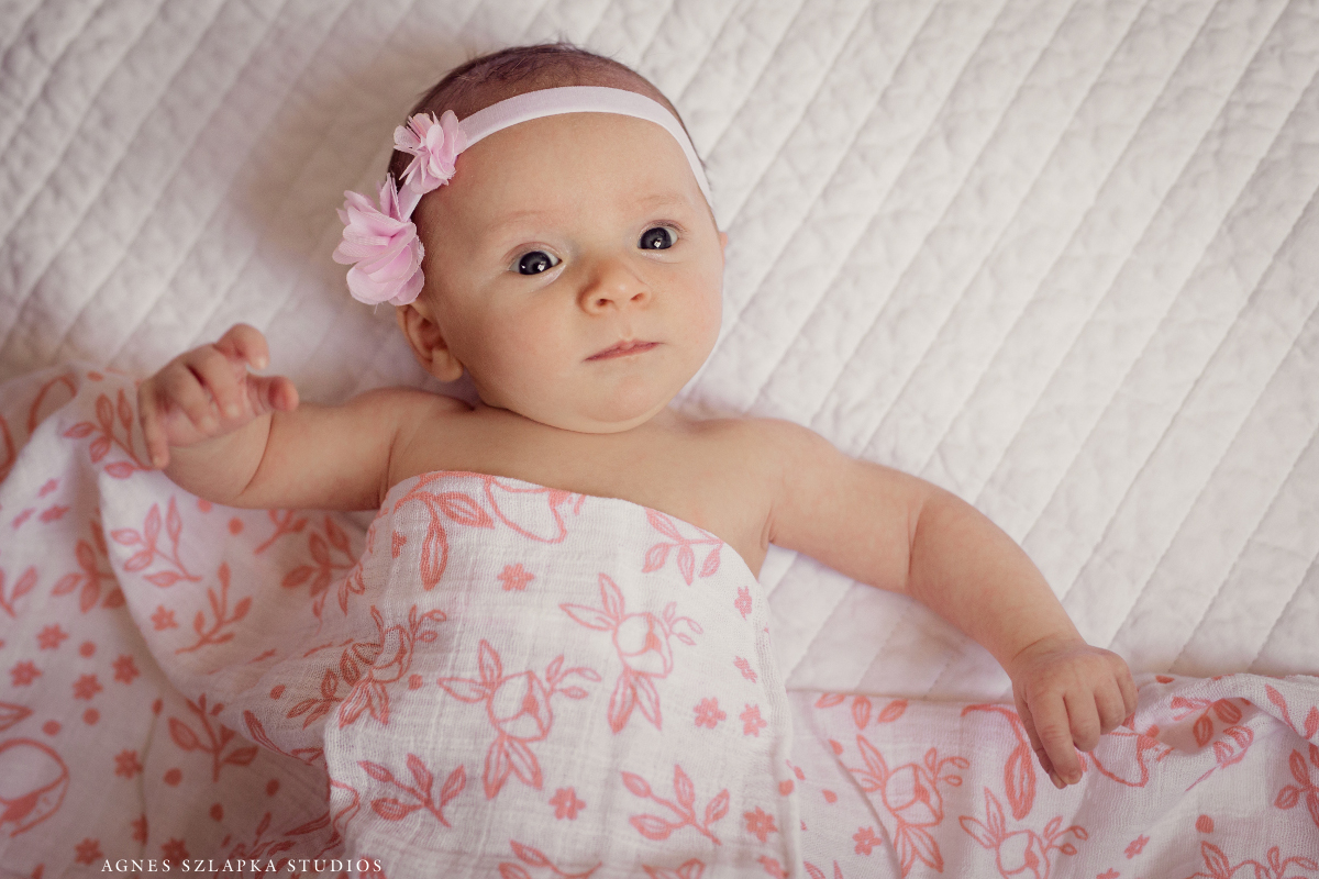 infant baby girl in floral wrap | cleveland, ohio lifestyle newborn photographer