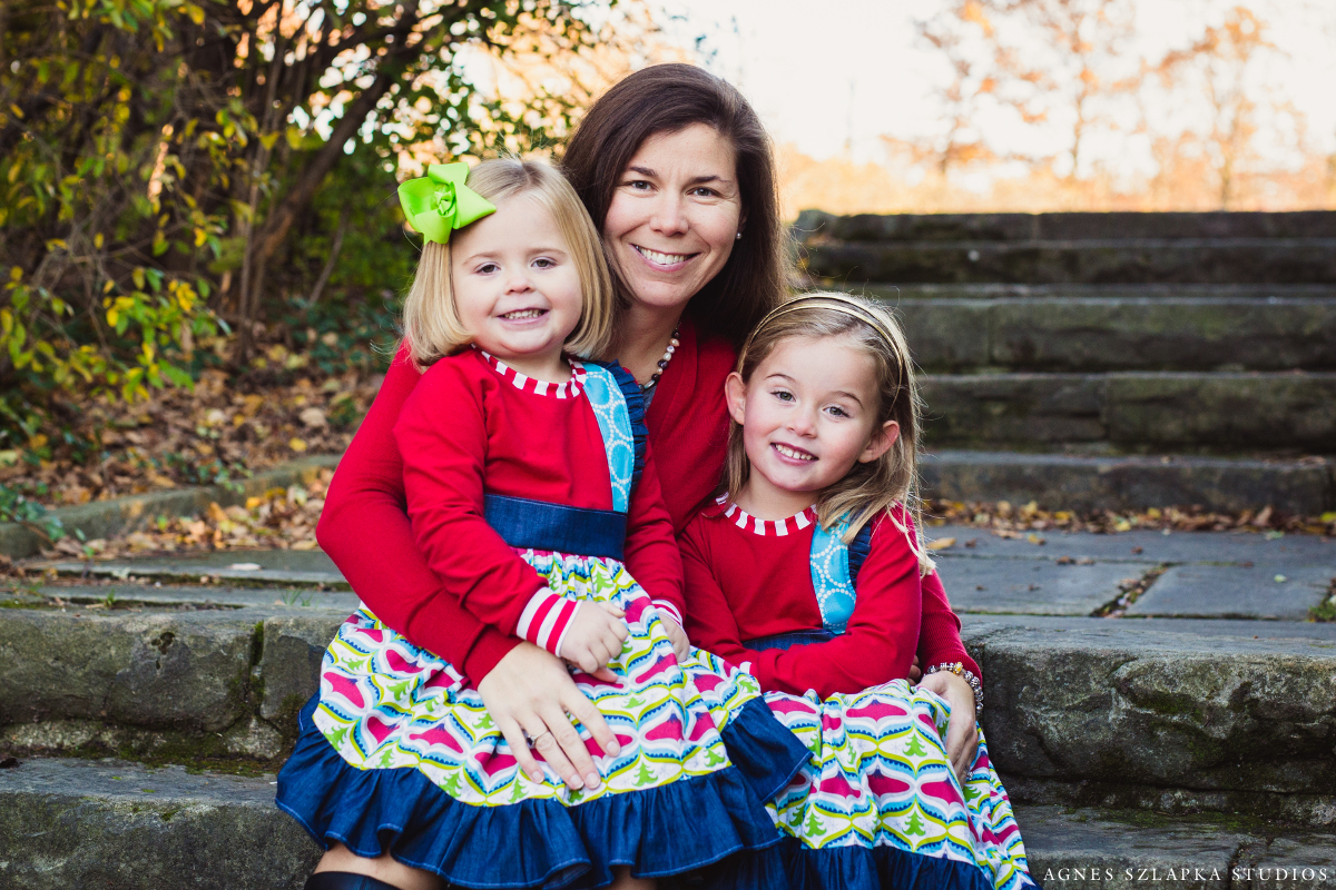 mom with two younger daughters on lap | cleveland, OH family photographer