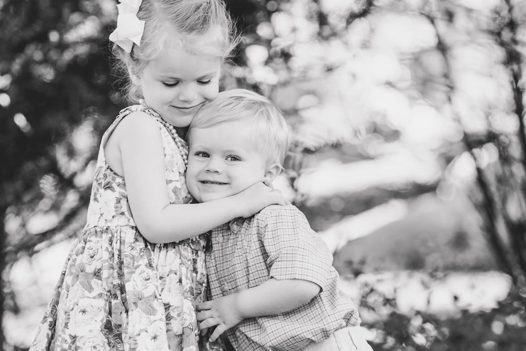 bis sister hugging little brother in garden | cleveland, ohio kids photographer