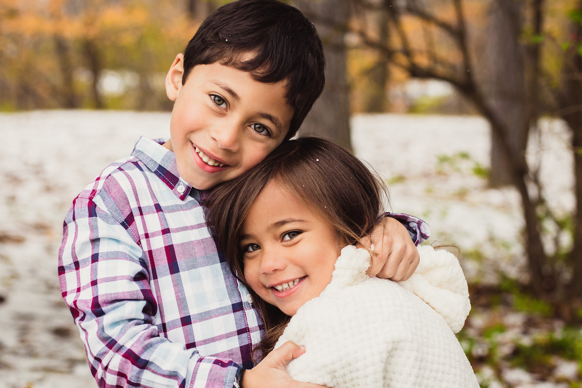brother hugging little sister during winter | cleveland, ohio kids photographer