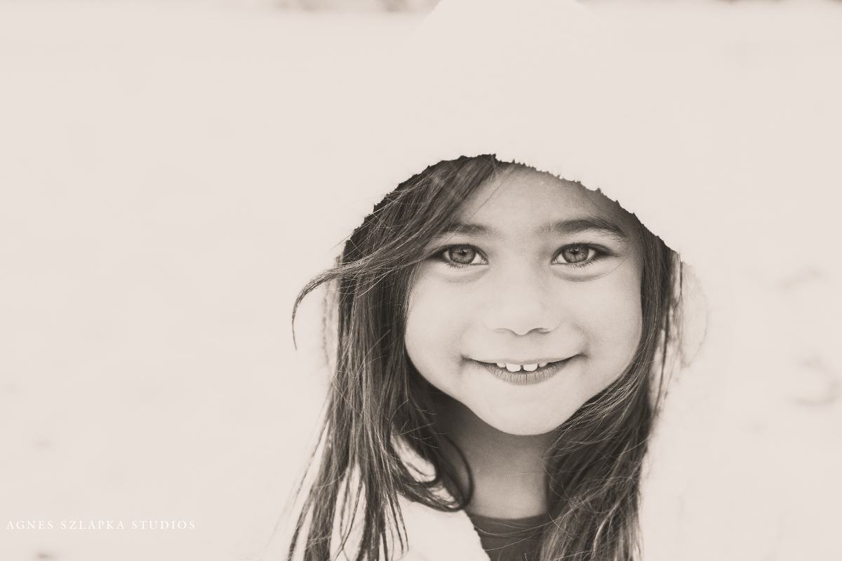 three year old girl with hood in snowy weather | cleveland, ohio kids photographer