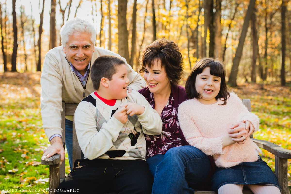 family of four sitting on bench | cleveland, ohio portrait photographer