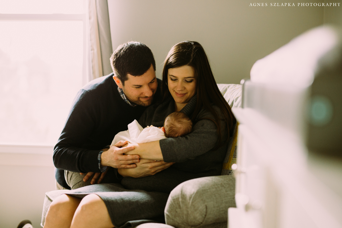 new parents with baby girl in arms | cleveland, ohio lifestyle newborn photographer