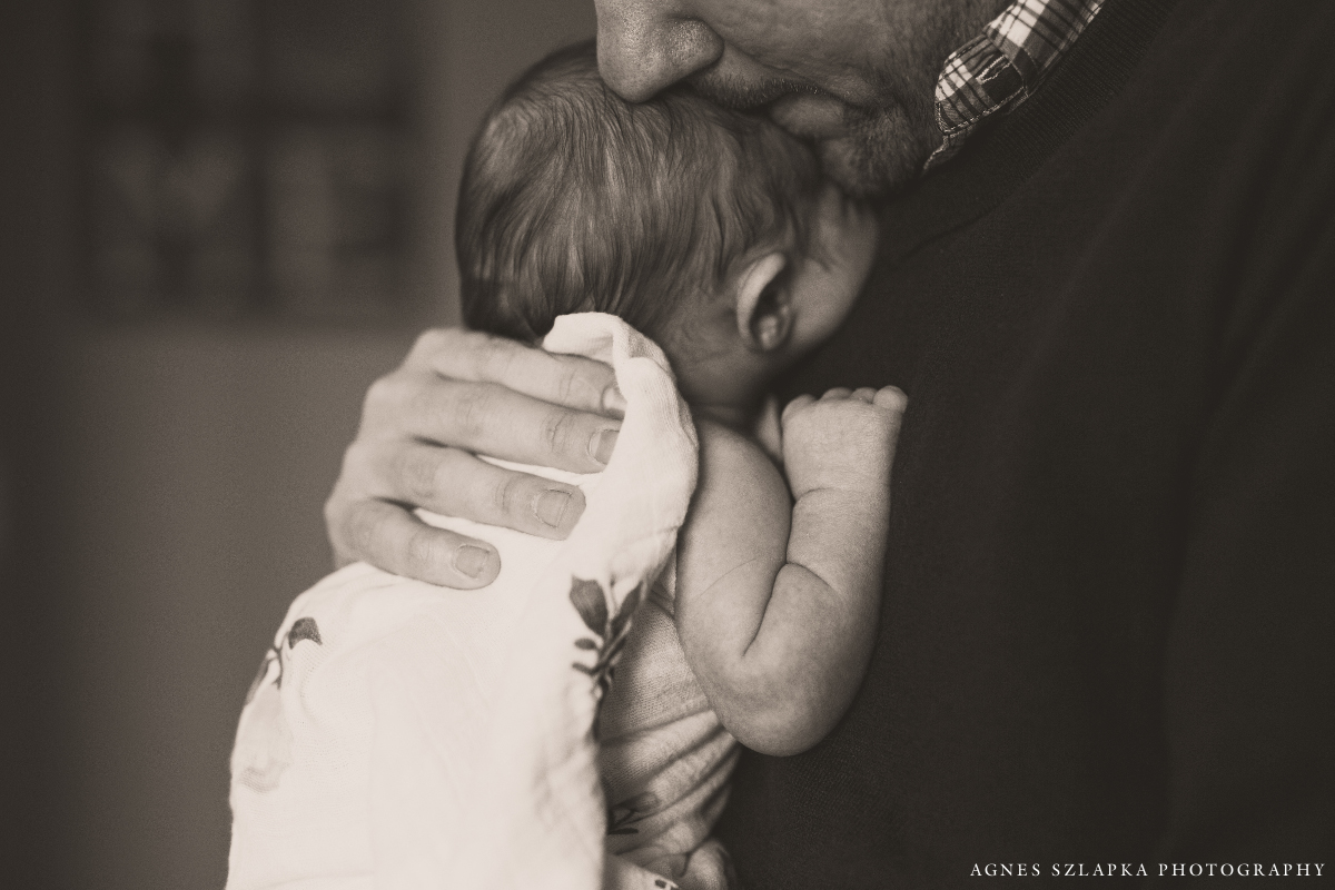 dad embracing little baby girl into his chest | cleveland, ohio baby photography
