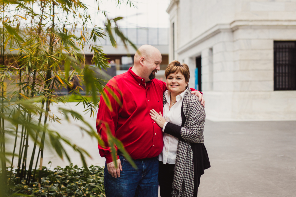 husband and wife standing near bamboo plants in museum | cleveland, ohio family photos