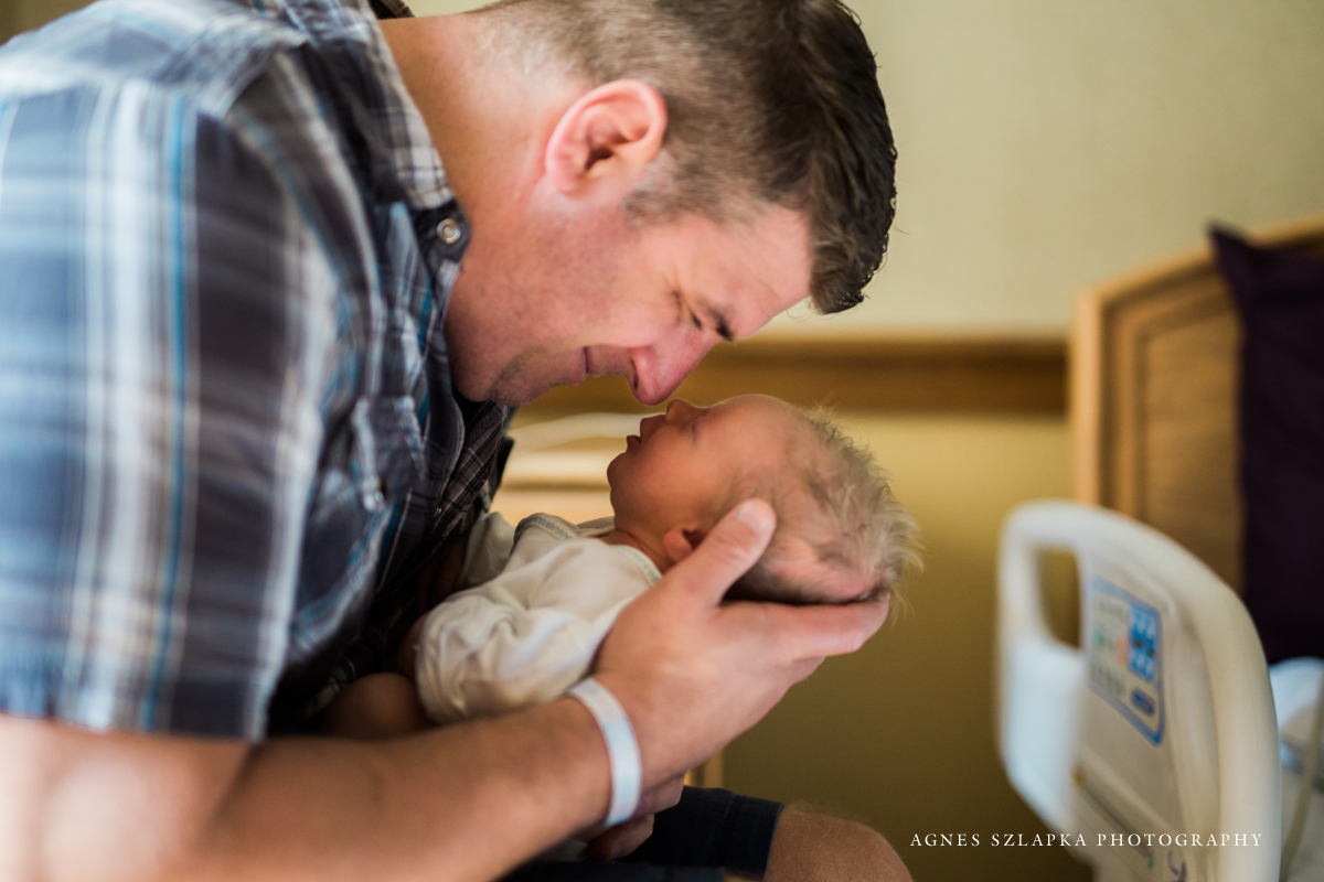 father holding baby son close to his face smiling | cleveland, ohio fresh 48 photography